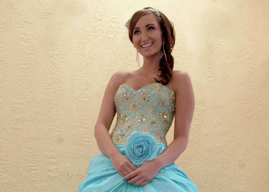 Nichole Judice wearing a gold and teal beaded Terani ball gown at Mommy Dearest in Beaumont. Dave Ryan/The Enterprise