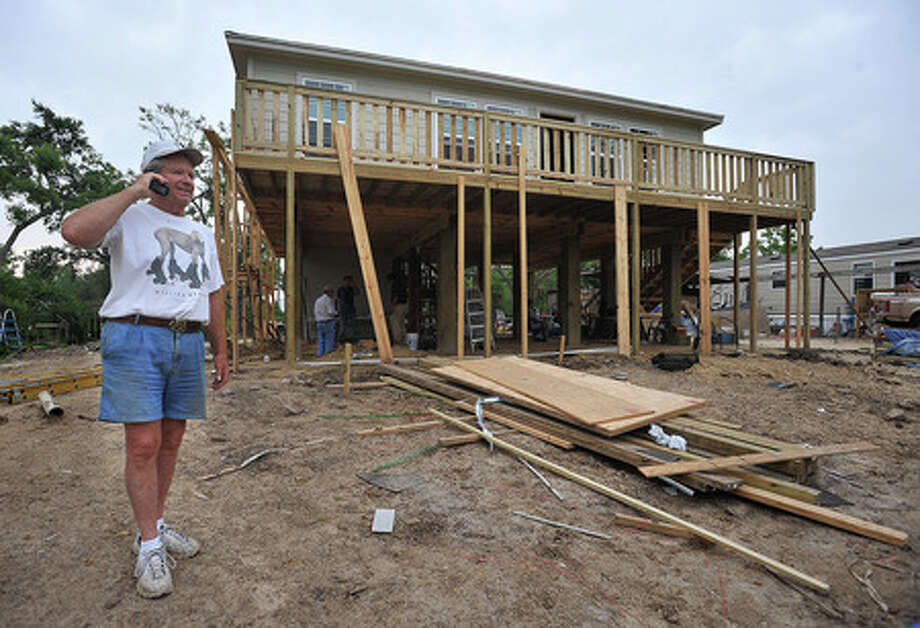 Chuck Jones stands in front of a home under construction on Oak Island. Supplies and volunteer hours are being donated by the First Assembly of God in Humble. Guiseppe Barranco/The Enterprise