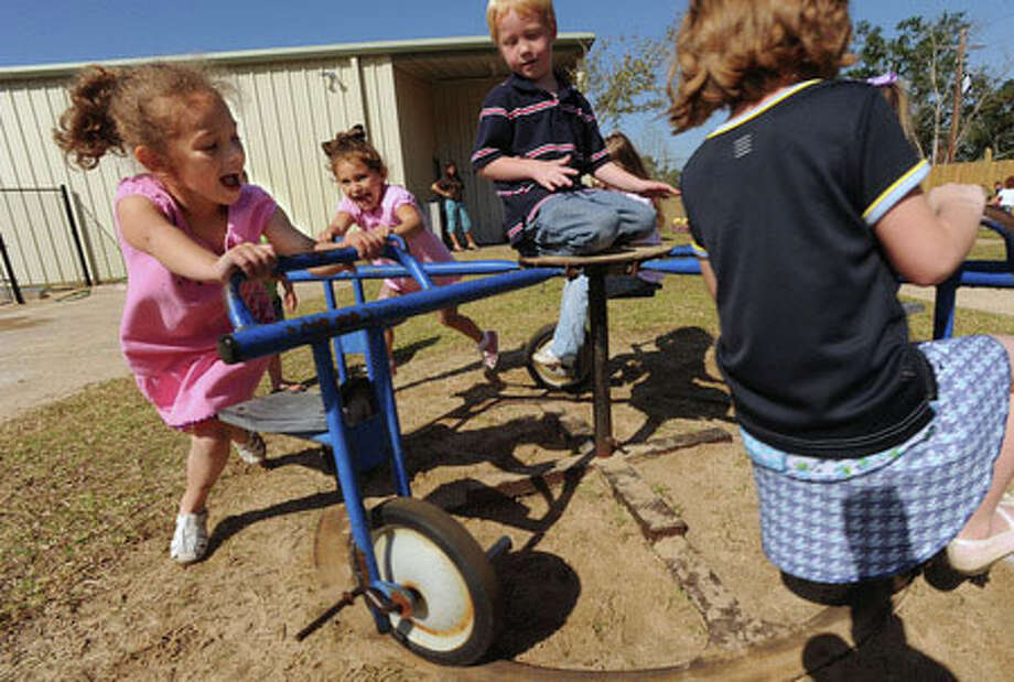 Bella Sarles, 4, pushes her friends on a playground ride at The Learning Center in Lumberton on Wednesday. Guiseppe Barranco/The Enterprise