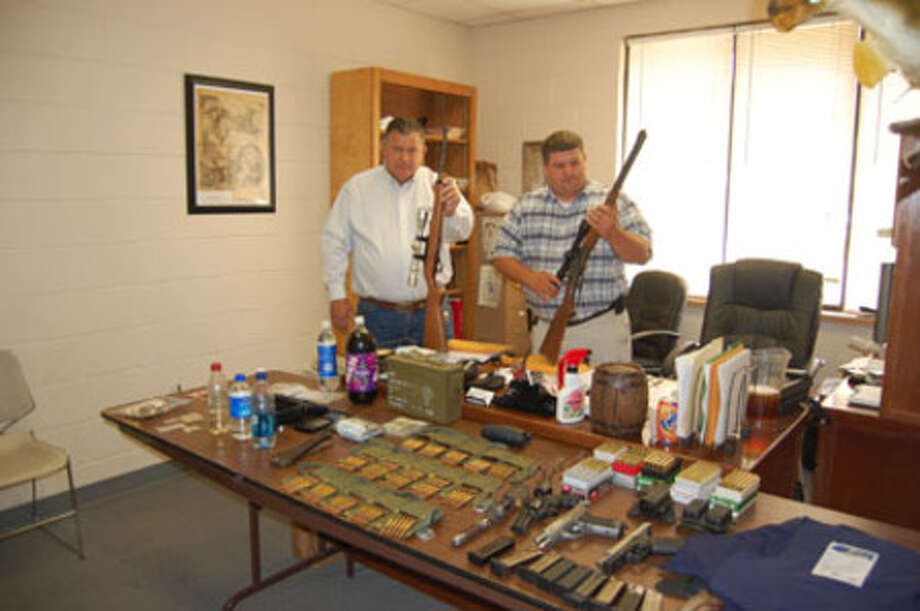 Jasper County Sheriff Mitchel Newman and Lt. Scott Duncan show off some of the seized property from a drug raid on a home the Evadale area.