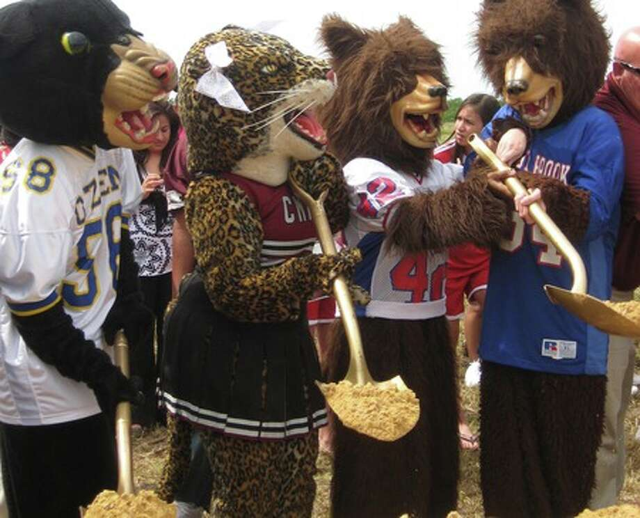 Mascots for Ozen, Central and West Brook high schools shovel dirt at the groundbreaking for the Beaumont Independent School District Multipurpose Facility. Emily Guevara/The Enterprise
