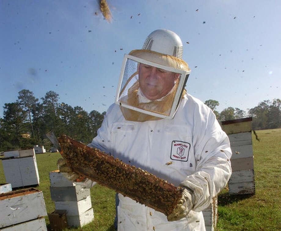 Bob Morlock, a bee keeper from North Dakota, winters his bees here and provides them to people in the area to pollinate their crops.  Dave Ryan/The Enterprise