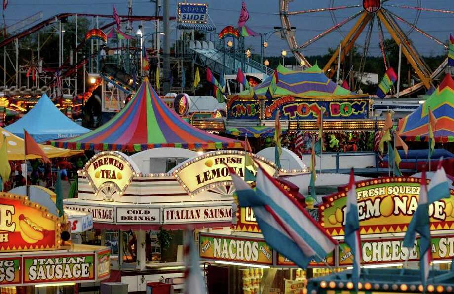 The midway offers food and rides during opening night of the South Texas State Fair at Ford Park in Beaumont on Thursday, Oct. 12, 2006. The fair continues through Oct. 22, 2006. (Photo/The Beaumont Enterprise, Mark M. Hancock) / Mark M. Hancock