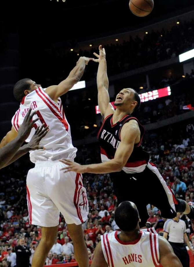 Houston Rockets' Shane Battier, left, knocks the ball away in the final minutes of Game 4 on Sunday, April 26, 2009, in Houston. The Rockets won 89-88 to lead the series 3-1. Pat Sullivan/The Associated Press / AP