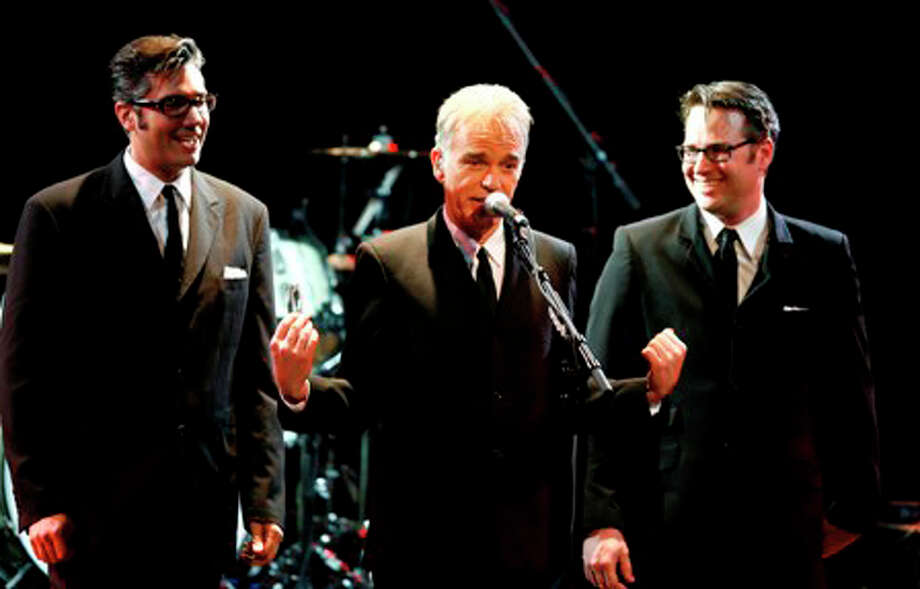 "Actor Billy Bob Thornton, center, appears with members of his band The Boxmasters Mike Butler, left, and J.D. Andrew during the second annual ""All For The Hall"" benefit for the Country Music Hall of Fame at the Nokia Theater Wednesday, Oct. 15, 2008 in New York.  (AP Photo/Jason DeCrow)"