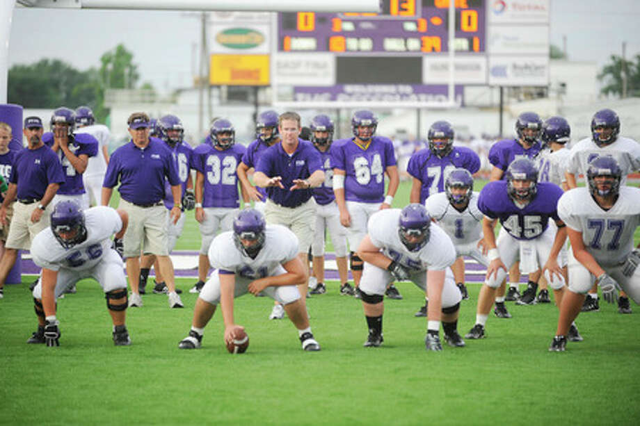PN-G coaches and players warm up for their annual  Spring scrimmage of the Purple vs. White varsity teams on Friday night at Indian Stadium.  Valentino Mauricio/The Enterprise
