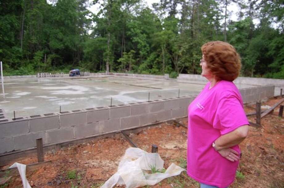 Donna Armstrong, member of the Jasper-Lakes Area Humane Society, gives a tour of their shelter. The shelter's contractor started construction, she said, and then left with $31,000.