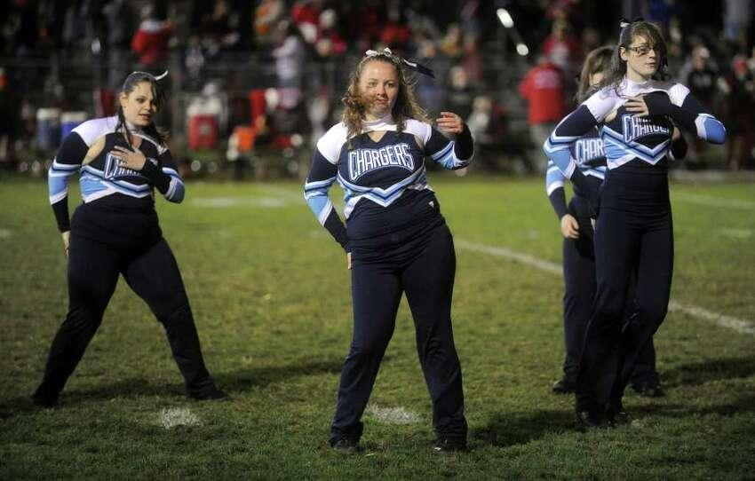 The Ansonia dance team performs during halftime of Friday's game at Jarvis Field in Ansonia on October 29, 2010.