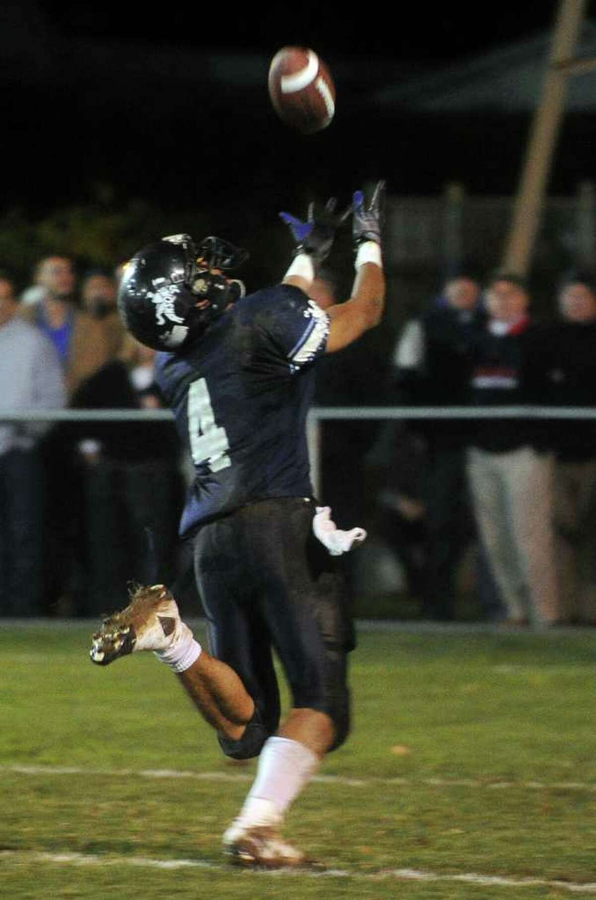 Ansonia's Andrew Matos reaches for an incomplete pass during Friday's game at Jarvis Field in Ansonia on October 29, 2010.