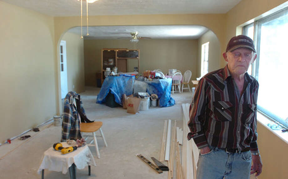 75-year-old LaBelle resident Harold Wyble hasn't informed Jefferson County yet if he going to accept their buy-out offer, but he's well on his way to finishning repairs to his flood-damaged home. Pete Churton/The Enterprise