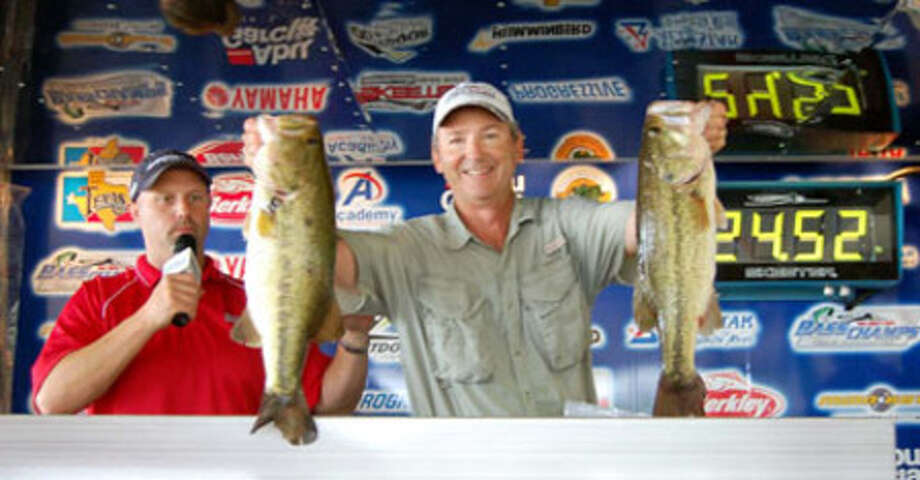 Fishing by himself, Doug McCain reeled in the winning 24.52 lb stringer to win the tournament ant $20,000!