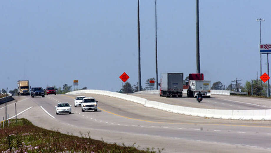 Traffic travels over the Texas 62 overpass on Interstate 10 Thursday. The region pooled its $11 million in federal highway stimulus money to rebuild about three miles of the highway east of this point. Pete Churton/The Enterprise