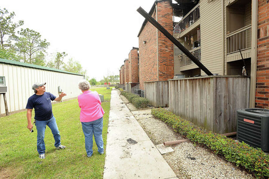 Ruby Holst, 81, looks over the fire damage at the Optimist Village apartments in Orange on Wednesday. A resident of the complex, Holst and many others have received many donated goods from the community. Guiseppe Barranco/The Enterprise