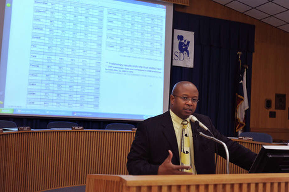BISD's Timothy Chargois announces the preliminary TAKS scores for all subjects at the administration building on Tuesday.  Guiseppe Barranco/The Enterprise