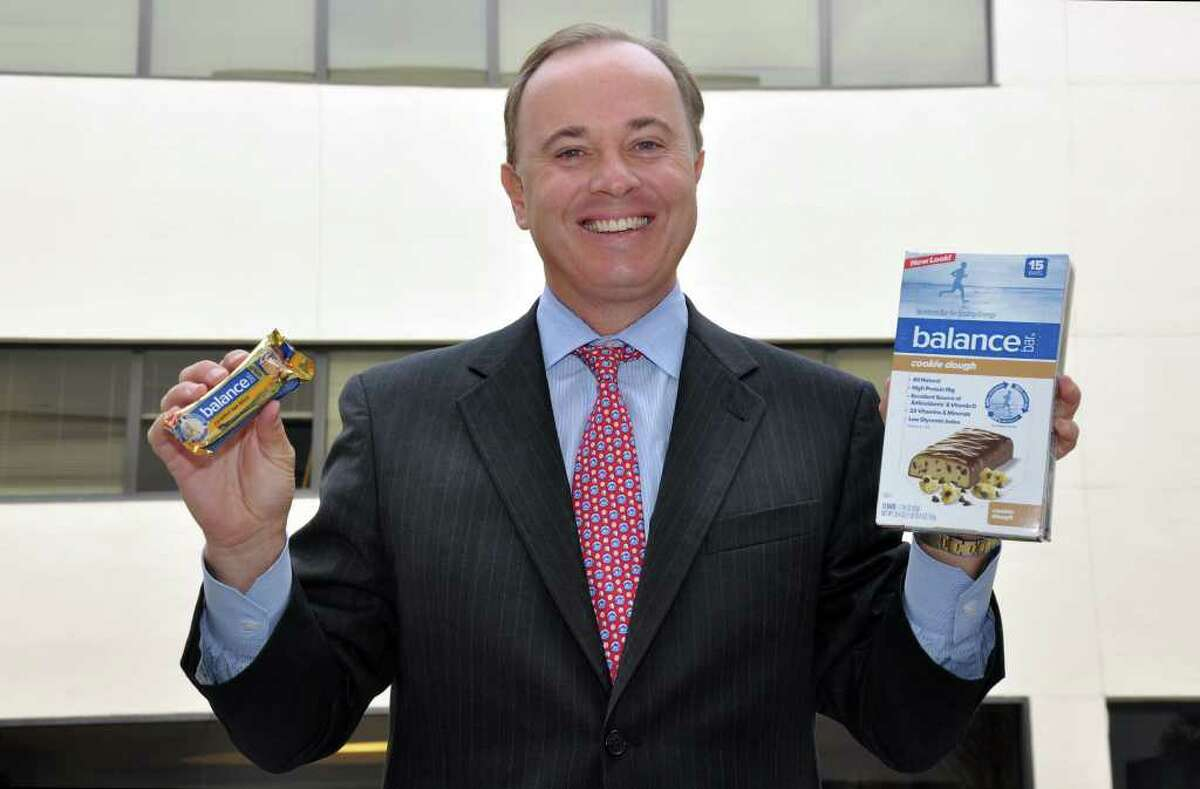 Henk Hartong, Brynwood's senior managing partner and chairman of the Balance Bar Company poses with the new Balance Bar packaging in the courtyard of 8 Sound Shore Drive, Greenwich on Wednesday, Oct. 20, 2010.
