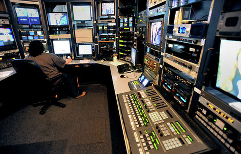 KFDM's Stacey Esclovon works in master control room at KFDM on Wednesday. The station plans to conduct several soft tests Thursday to assess how prepared Southeast Texas is for the digital television transition on June 12. Guiseppe Barranco/The Enterprise