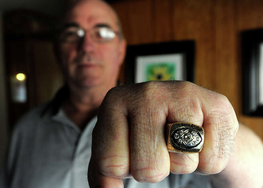 John Elliot poses with his Super Bowl III ring at his home in Wildwood. Elliot played for the Jets. Wednesday, January 28, 2009 Guiseppe Barranco/The Enterprise