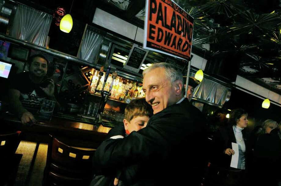Republican candidate for governor Carl Paladino gives 12-year-old Carl Fiore of Clifton Park a hug as he greets people on a campaign at Quintessence Diner in Albany Friday morning 10/29/2010.(Michael P. Farrell / Times Union) Photo: Michael P. Farrell