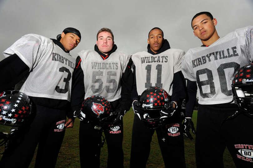 Kirbyville Wildcats defensive linemen, from left, Decovin Booker, Aaron Walters, Desmond Everett, an