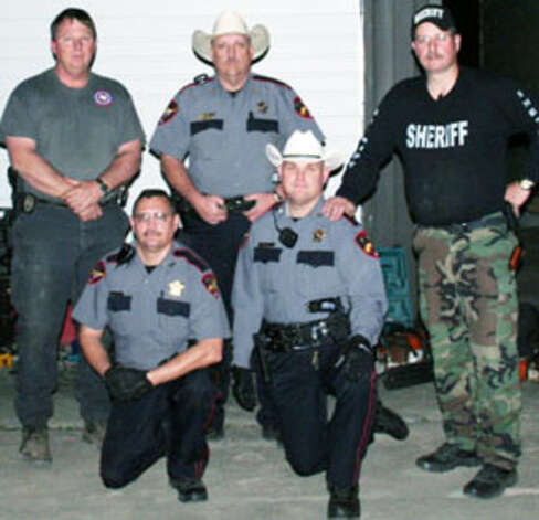JASPER COUNTY sheriff?s deputies pose with more than