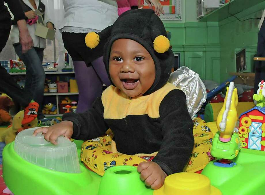 Six-month-old Symere Harvard of Troy sports a bumble bee costume as children from the Unity Sunshine Program march in a halloween costume parade through the YWCA in Troy, NY on October 29, 2010.  (Lori Van Buren / Times Union) Photo: Lori Van Buren