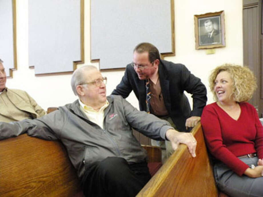 Judge Joe Bob Golden relaxes in Judicial District 1 courtroom with Steve Seale and Kristi Hollis