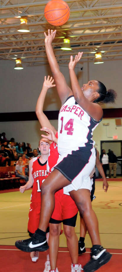 Jasper?s Andreia Castle drives in for a bucket against Carthage. Castle led Jasper's scoring effort with 16 points.