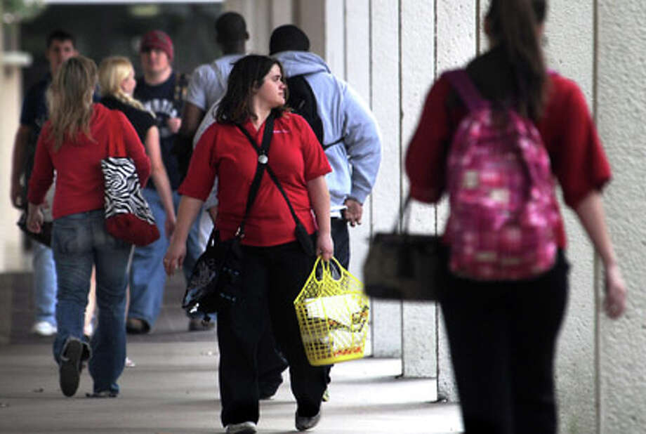 Students walk through campus near the John Gray Library at Lamar University in Beaumont, Wednesday. Tammy McKinley, The Enterprise