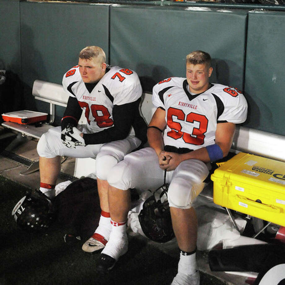 Wildcats offensive linemen, Robert Burge, left, and Frank McMickell, react to losing a tough Class 2A Division 1 state championship battle, 48-26, against the Muleshoe Mules, in Grand Prairie at Gopher Stadium on Saturday. Valentino Mauricio/The Enterprise