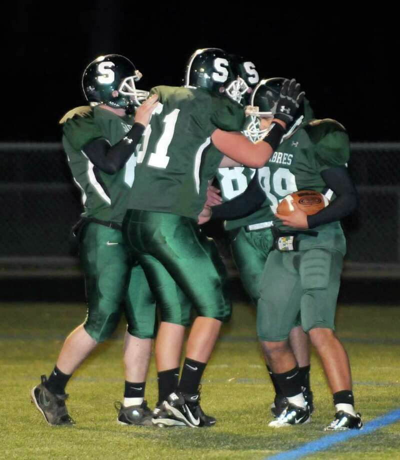 High school football -- Schalmont's Alberto Beltran, right, celebrates his touchdown against Albany Academy. (Hans Pennink / Special to the Times Union) Photo: Hans Pennink