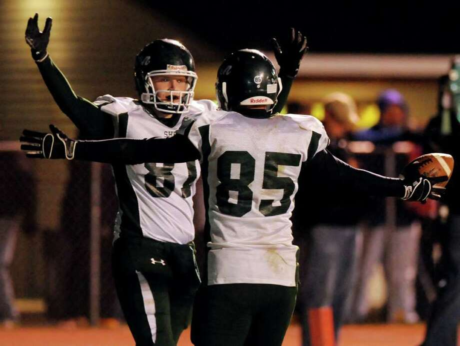 High school football -- Shenendehowa's Brandon Miller (85), right, celebrates his game-sealing touchdown with David Boyle. (Cindy Schultz / Times Union) Photo: Cindy Schultz