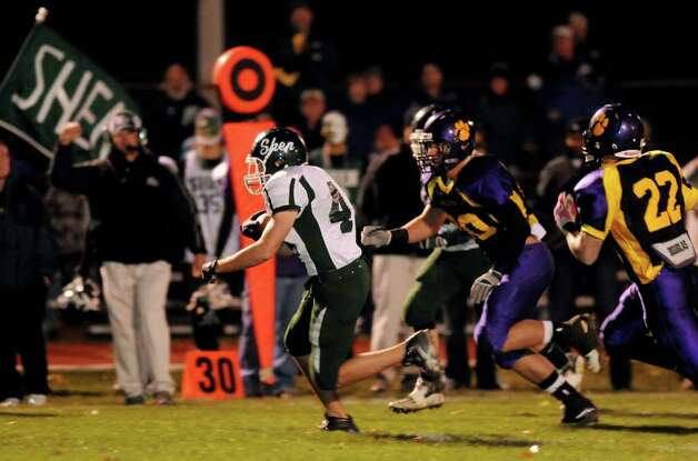 High school football -- Shenendehowa's Chris Sutton (44) carries the ball down the sideline during their football game against Ballston Spa. (Cindy Schultz / Times Union) Photo: Cindy Schultz