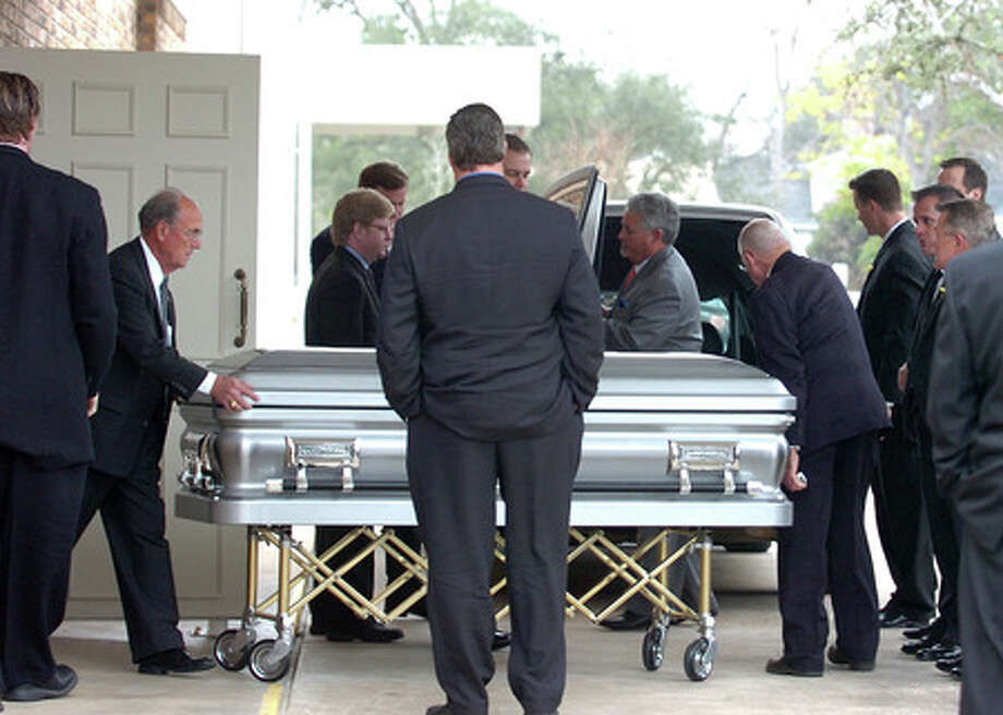 Funeral caretakers walk the body of Shane Dronett to a waiting hearse at Claybar Funeral Home in Orange on Sunday, January 25, 2009. Guiseppe Barranco/The Enterprise