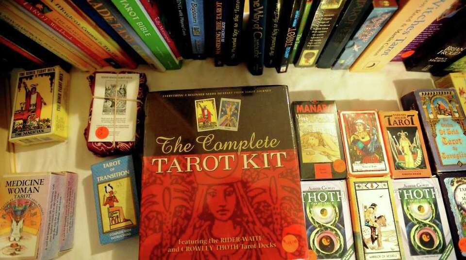 A variety of Tarot decks are on display and available for purchase at Edana Winema's home in Kirbyvi