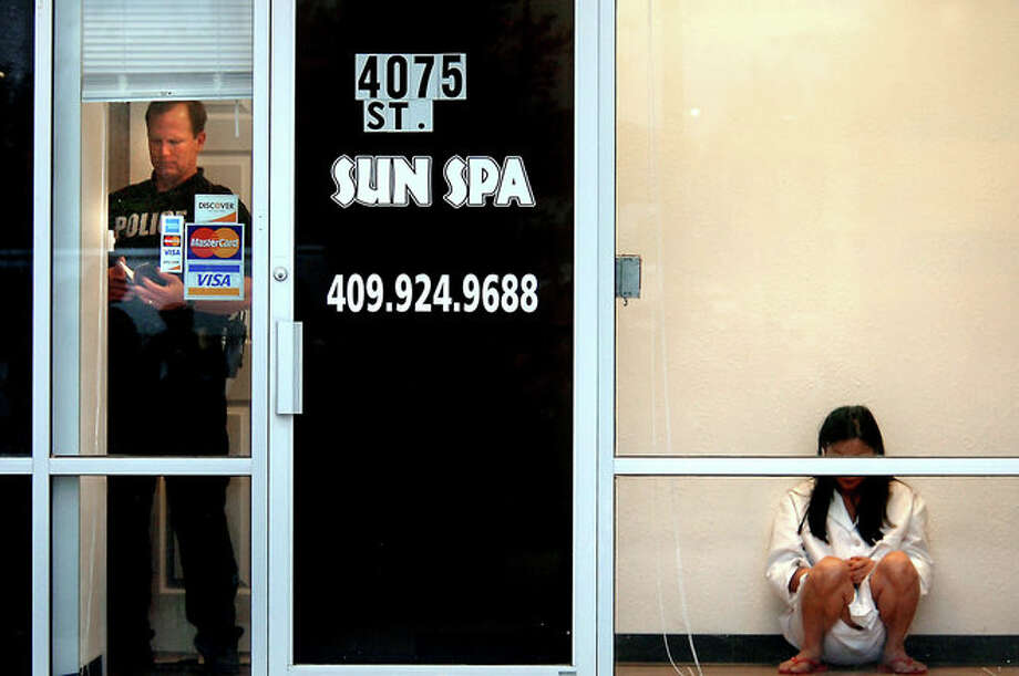 The Beaumont Police Department raid an alleged prostitution ring at Sun Spa in Beaumont on May 7, 2008. Beaumont Enterprise/Tammy McKinley