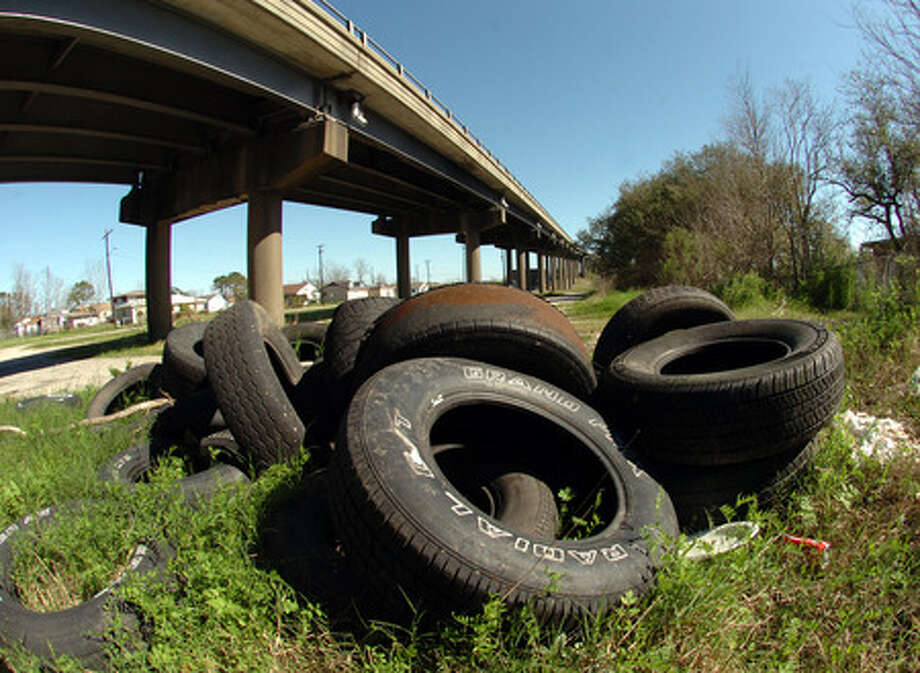 Illegal tire dumping, like this pile at the base of the Dr. Martin Luther King Jr. Bridge, has become a problem in Port Arthur. Pete Churton/The Enterprise