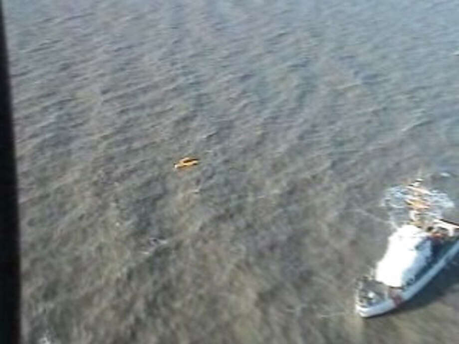 The scene of the crash of a Rotorcraft Leasing Company  helicopter two miles off of Sabine Pass in the Gulf of Mexico in a frame from a US Coast Guard video of the scene. Photo/USCG