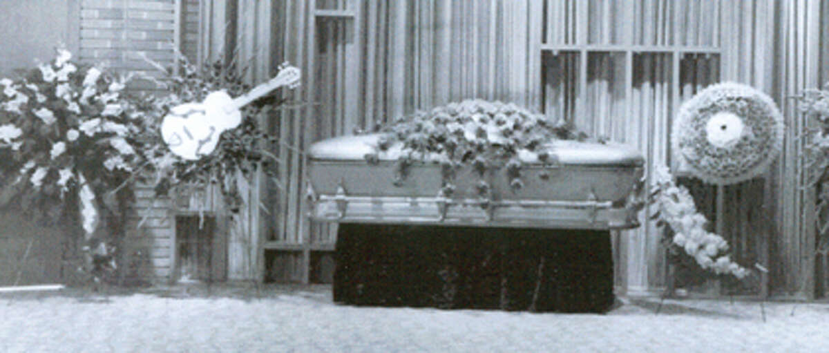 The casket of J.P. Richardson, better know as 1950s pop star the Big Bopper, was photographed at Broussard?s Funeral Home just before his 1959 burial. The guitar-shaped wreath at left was sent by then-U.S. Army Pfc. Elvis Presley. Photo provided by the Richardson family