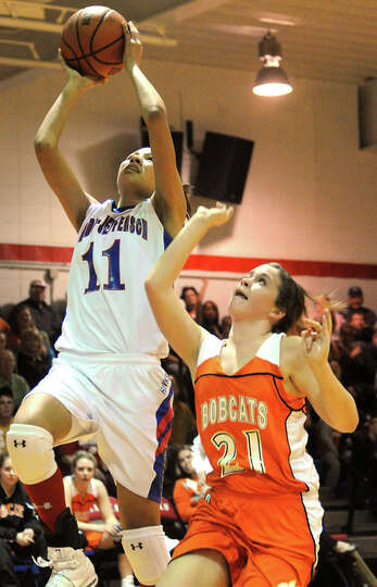 Hardin Jeffferson's Victoria Fontenot goes up for two points as Orangefield's Kasidy Hayes tries to