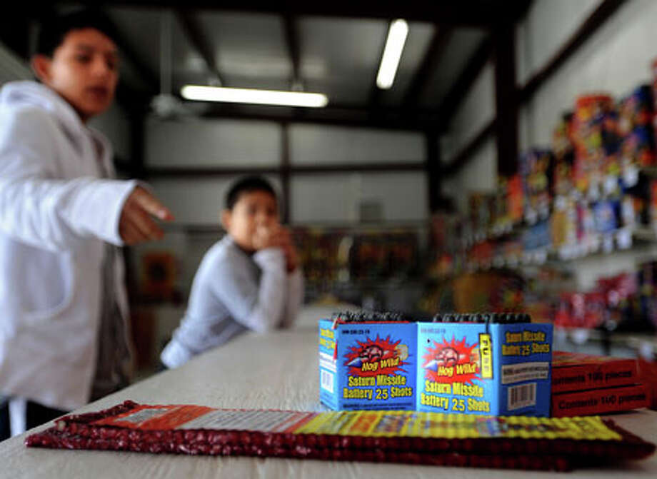 Alan Melgarejo (14) and Ivan Melgarejo (8) shop for fireworks at Ray's Fireworks on Highway 105 in Beaumont, Tuesday. Tammy McKinley, The Enterprise