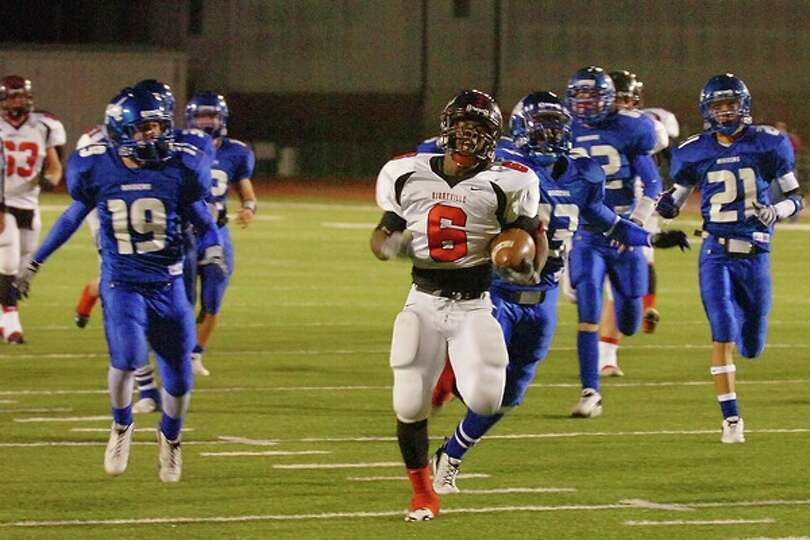 Wildcats running back, Barry Burley, rushes for a 29-yard touchdown  in the second quarter against