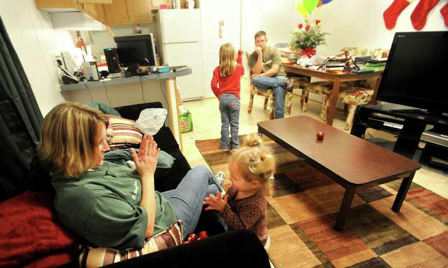 Dawn, Grace, Destiny, and Eric Bergeron spend some family time in the FEMA trailer they are living in while they wait for the repairs to their home to be complete in Rose City, Wednesday. Tammy McKinley, The Enterprise