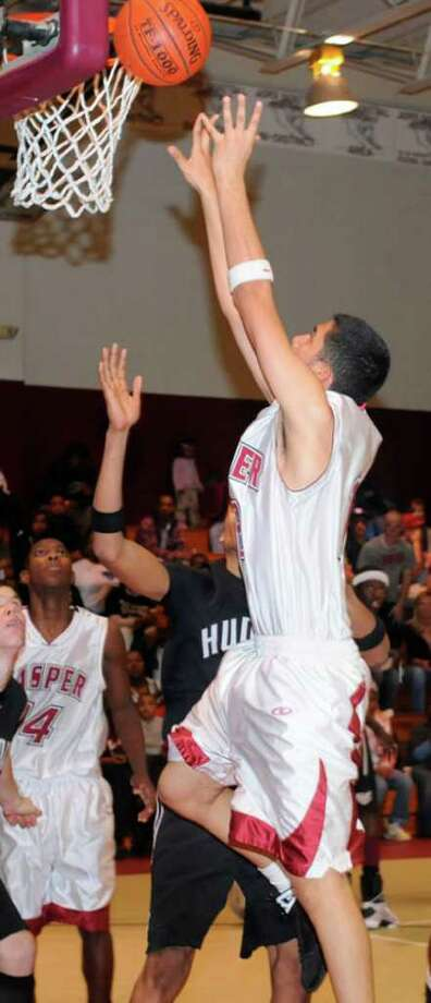 Jasper?s Pete Fuentes goes up for a rebound during Jasper?s victory over state-ranked Hudson last week.