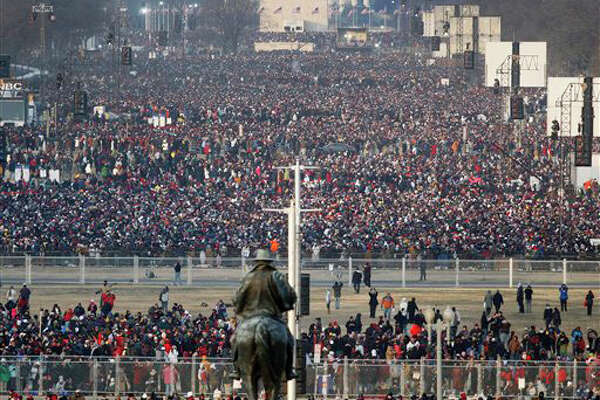 Crowds gather on the National Mall in Washington for the swearing-in ceremony of President-elect Barack Obama on Tuesday, Jan. 20, 2009. (AP Photo/Ron Edmonds)