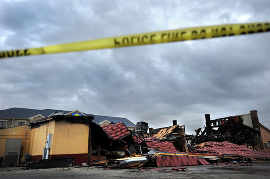 The roof of the Acapulco Mexican restaurant lies on the ground Sunday afternoon after a fire destroyed the facility earlier that day.  Guiseppe Barranco/The Enterprise