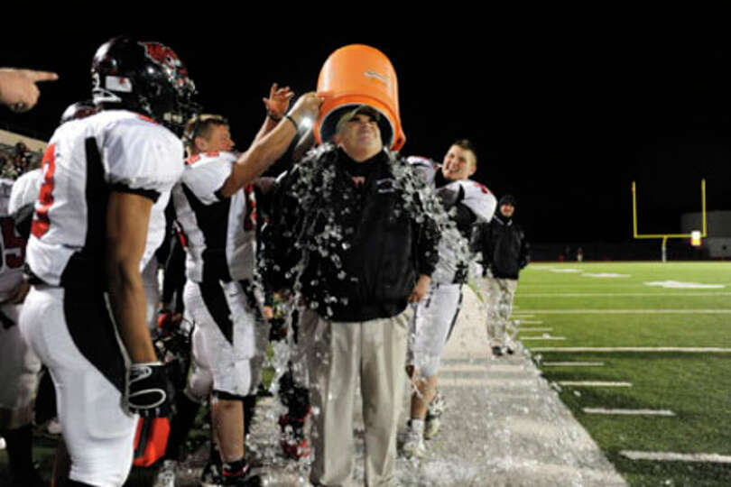 Kirbyville's  Jack Alverez gets the Gatorade treatment after the Wildcats routed Rice Consolidated,