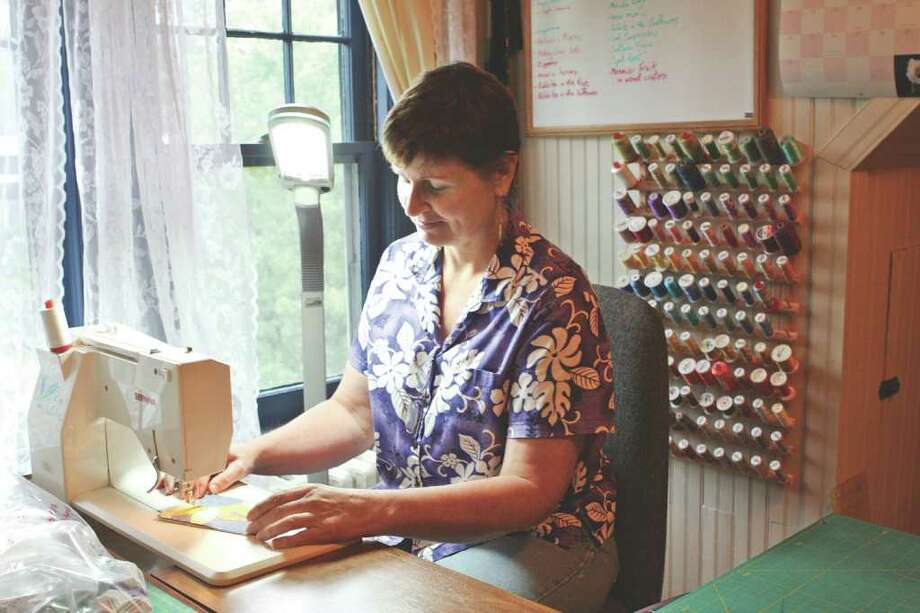 (Krishna Hill/Life@Home) Kim LaPolla on her love of quilting: ?It?s part of everyone?s life. It?s something you can touch.? Photo: Krishna Hill