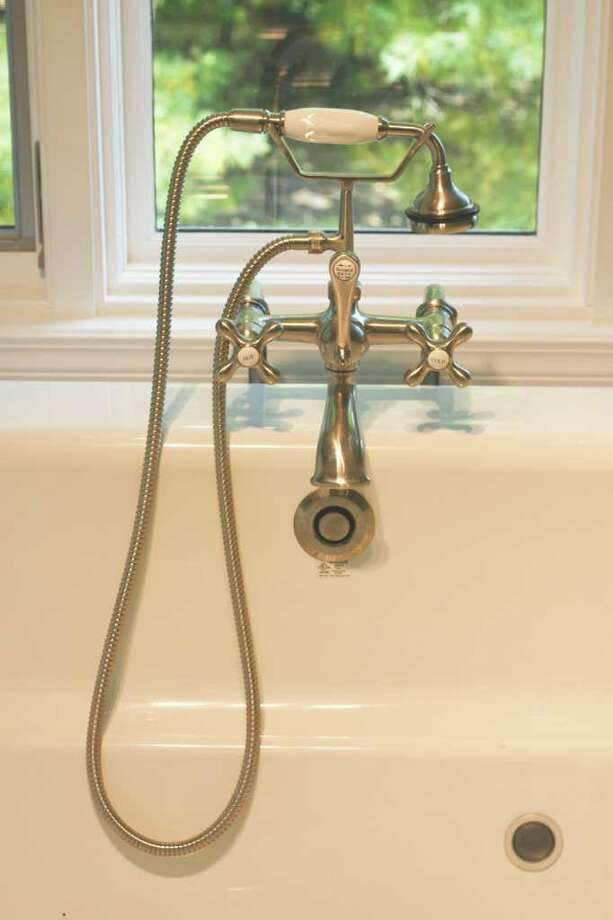 (Colleen Ingerto/Life@Home) After: Detail of bathtub fixtures