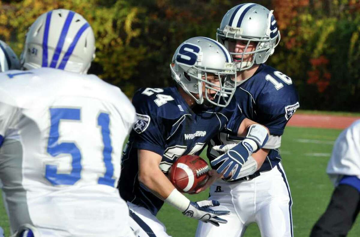 Staples' quarterback Jack Massie hands the ball to Tyler Jacobs during the varstiy football game against Fairfield Ludlowe at Staples High in Westport on Saturday, Oct. 30, 2010.