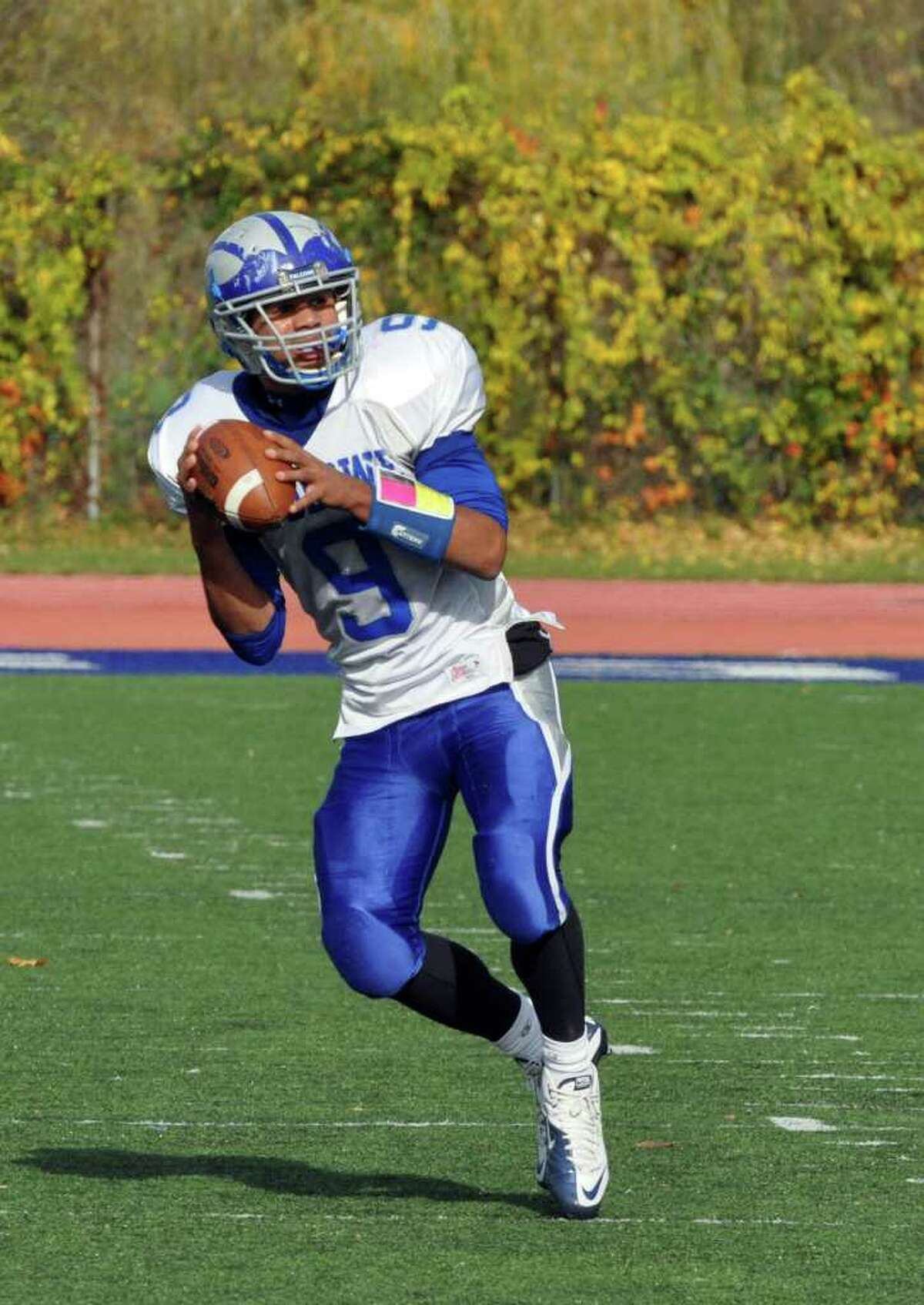 Fairfield Ludlowe's Tom Hammons looks to pass during the varstiy football game against Staples at Staples High in Westport on Saturday, Oct. 30, 2010.